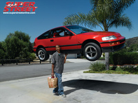 Super Street - Guy holding a Honda CRX in one hand