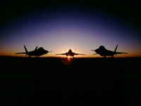 Raptor fighter planes sunset USA air force