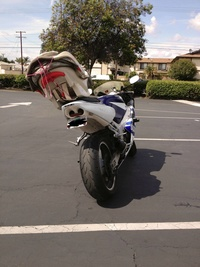 Careful parent - Baby car seat on a motorcycle
