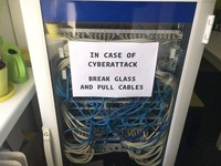 Meanwhile at MICROSOFT... In case of CYBERATTACK, BREAK GLASS AND PULL CABLES!