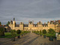 A view of the front Fontainebleau Chateau during sunset
